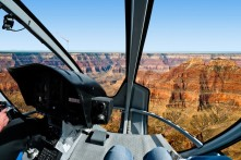 A bird's eye view of the Grand Canyon from the front seat of a helicopter.