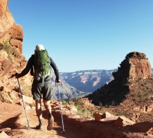 A lone hiker explores a Grand Canyon trail.