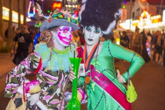 Two women dressed as a clown and the Bride of Frankenstein in Downtown Las Vegas