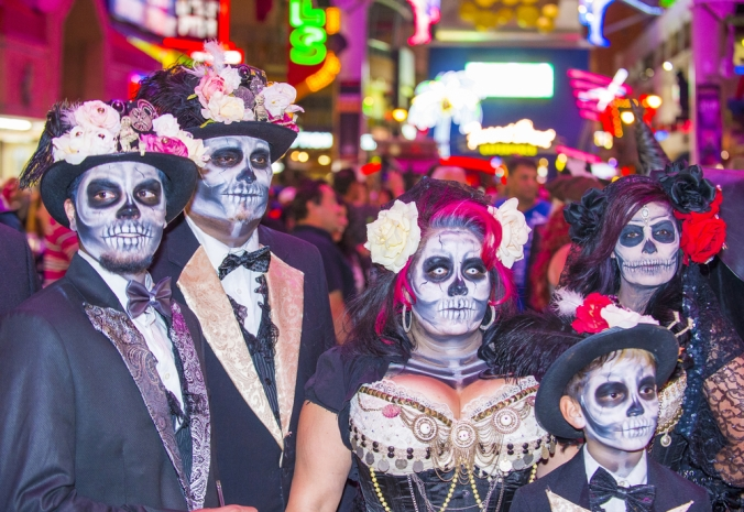 Visitors in costumes celebrate Halloween in Downtown Las Vegas.