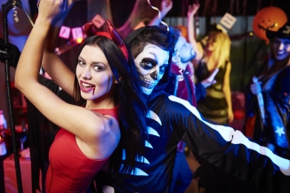 Couple dancing at a Halloween Party