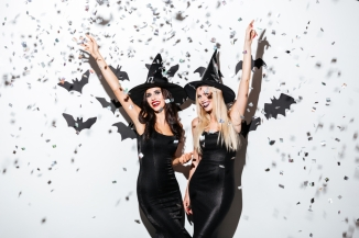 Happy ladies dressed as witches for Halloween