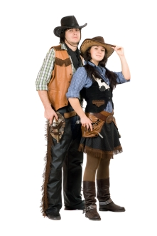 Couple wearing matching cowboy and cowgirl costumes